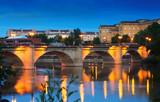 ancient stone bridge over Ebro  in evening. Logrono