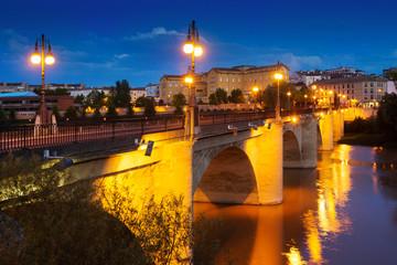 Old bridge  over Ebro river in night. Logrono, Spain