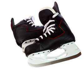 Pair of black hockey skates isolated on white background