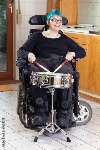 Leinwanddruck Bild Happy young woman with infantile cerebral palsy.