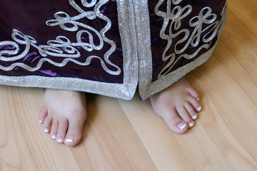 girl's feet in Moroccan suit