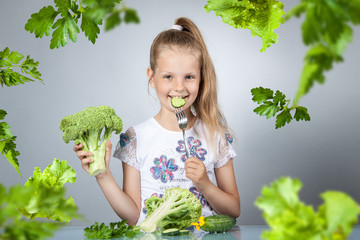 Girl eats vegetables