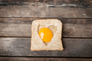 Egg with whole grain bread wooden background