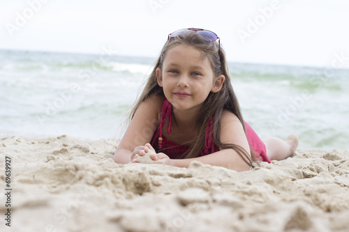 canvas print picture child on a sandy beach