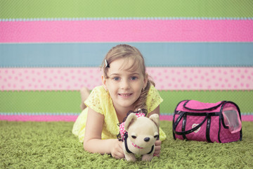 Young girl playing with toys on the carpet