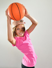 child exercising with dumbbells and ball