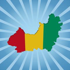Guinea map flag on blue sunburst illustration