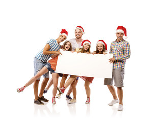 Young people in santa hats