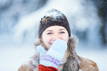 Winter portrait of young happy woman.