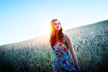 Young woman portrait in straw field