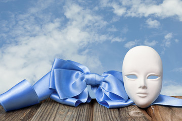 Mask with a blue bow