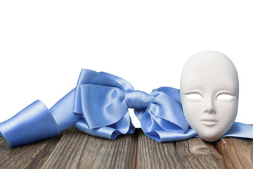 Mask with a blue ribbon on white background