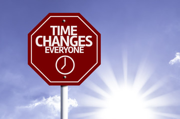 Time Changes Everyone red sign with sun background
