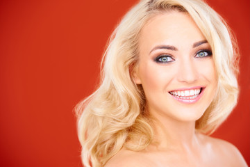 Beautiful young blond woman with a beaming smile