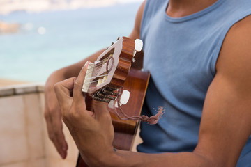 hand of a musician make chord