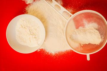 Preparation for baking, ingredients flour sifting.