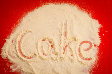 Close up of word cake written in flour