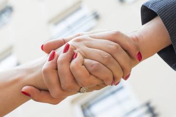 Handshake of two women