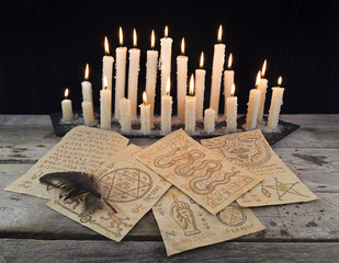 Magic papers with candles and quill
