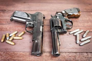 Black revolver gun and Semi-automatic 9mm gun