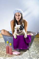 Woman bathing a dog