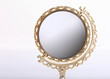Leinwandbild Motiv golden makeup mirror isolated