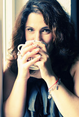 beautiful 35 years old woman holding cup of morning coffee