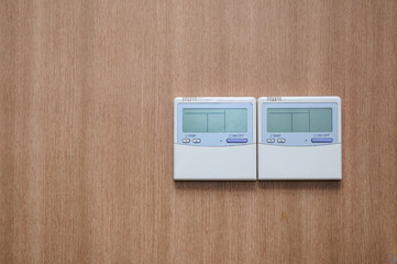 Digital thermostat on wood wall
