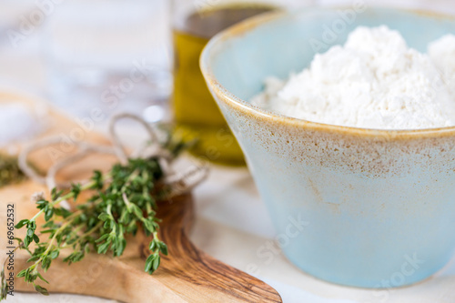 Fotobehang Kruiderij Cozy rustic home kitchen still life, dried herbs thyme, salt in