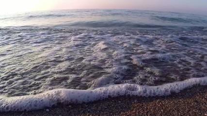 Black sea waves over sand beach holiday background. Coastline.