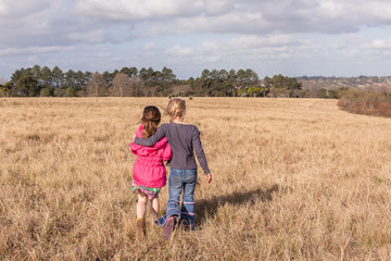 Young Girls Together Walking Grass Field