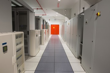 Empty hallway of server towers