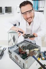 Weird computer engineer fixing broken cpu