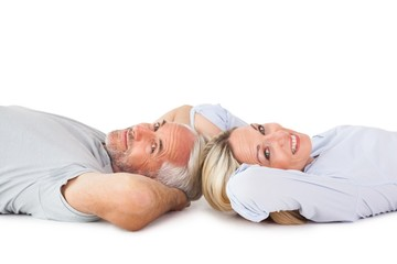 Smiling couple lying and looking at camera