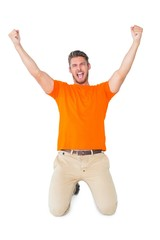 Excited man in orange cheering
