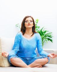 Woman sitting in yoga pose.