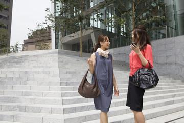 Modern building, two young women