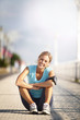 canvas print picture - Cheerful jogger stretching after exercising in the street