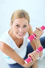 Upper view of fitness girl holding dumbbells