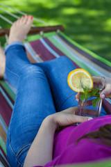 Lady resting on hammock