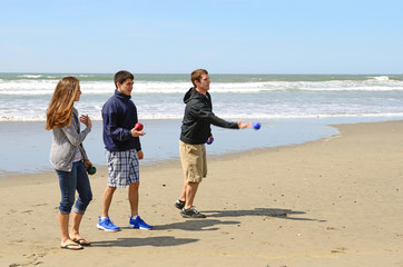 Young adults playing Bocce Ball on the beach near Bandon Oregon
