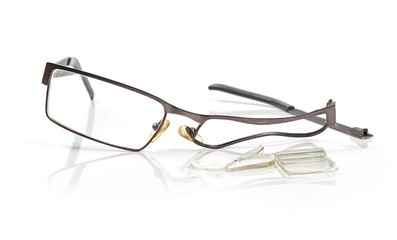 broken eyeglasses isolated on white