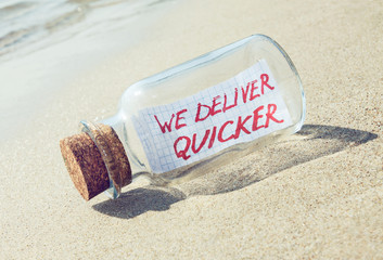 Creative transportation concept. Message in a bottle with text.