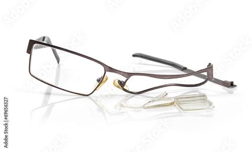 broken eyeglasses isolated on white - 69656327