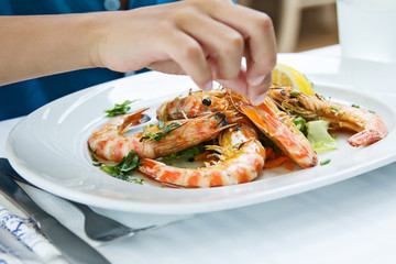 Plate with colorful king prawns in restaurant. Sea food concept.