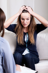 Desperate young woman on psychotherapy session