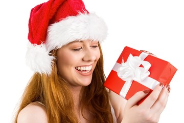 Festive redhead holding a gift