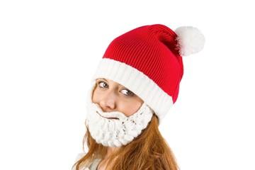 Pretty redhead in santa hat and beard