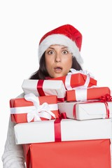 Shocked woman with christmas presents
