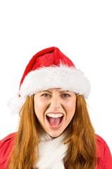 Festive redhead shouting at camera